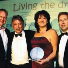 Lois, Antony and Tim winning a business award